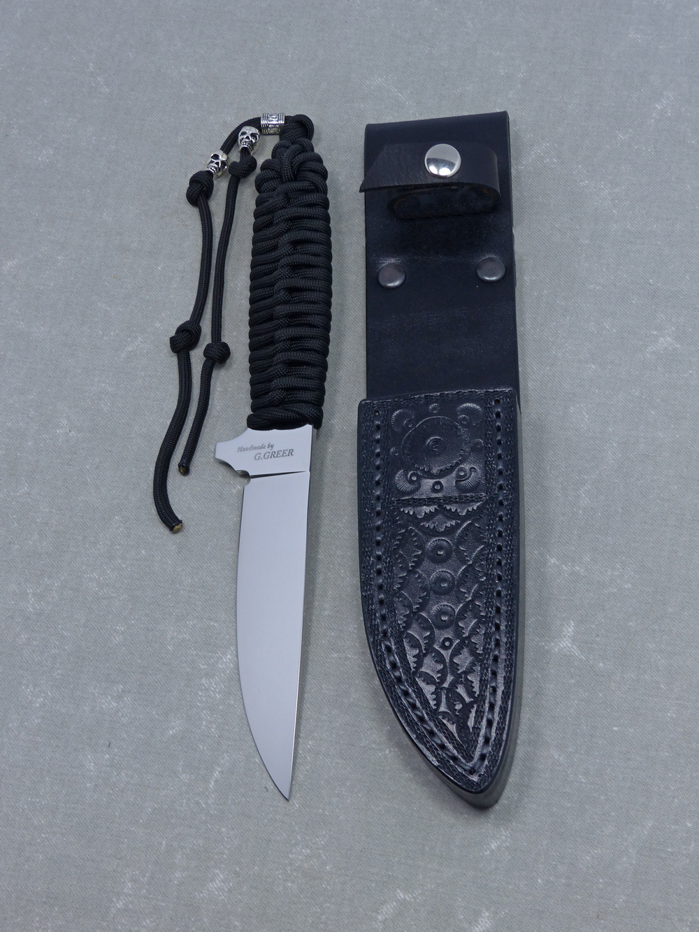 Black paracord tactical knife and sheath