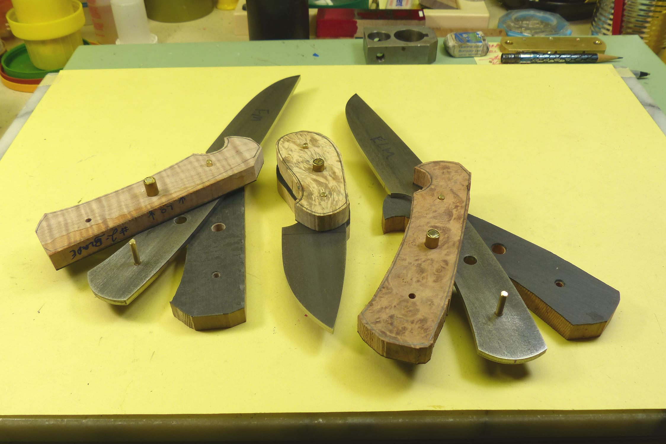 Handles being fitted to knife blanks