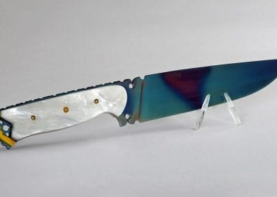 8 Knife with pearl polymer handle and peacock blue oxidized blade
