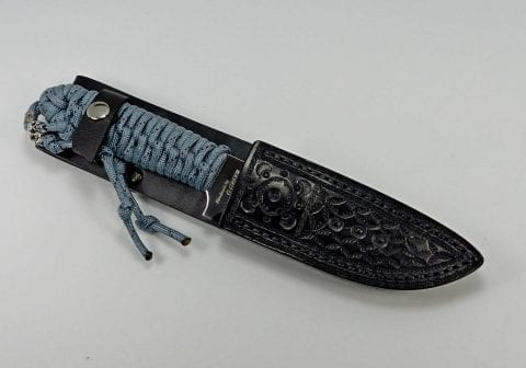 P-2 Titanium paracord utility knife inside custom fitted leather sheath