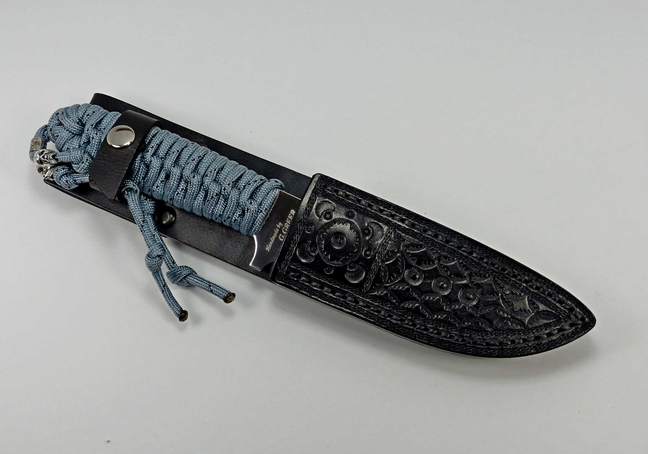 P-2 Titanium colored paracord utility knife inside custom fitted leather sheath