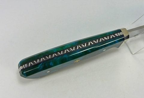 Intricate filework inside blue handle art knife