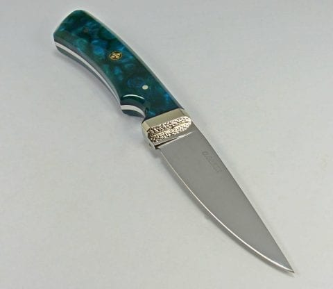 Art knife with blue pearlescent handle and dimpled guard
