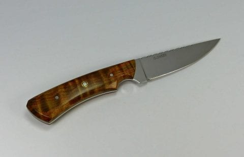 Hunting knife with unique two-tone brown and green color in handle