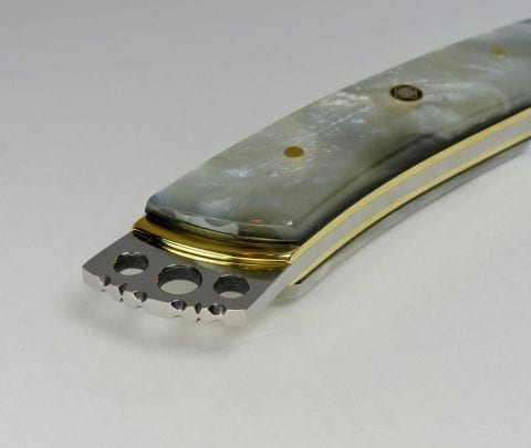 Fancy pearl polymer knife showing filed rear crown - S18