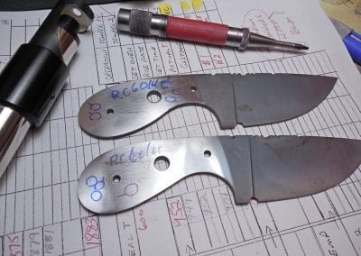 Knife blades being tested for Rockwell hardness